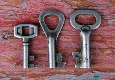 Tre vecchi tasti arrugginiti Fotografia Stock Libera da Diritti