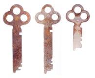 Tre vecchi tasti arrugginiti su bianco Fotografia Stock Libera da Diritti