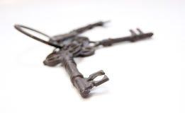 Una vecchia chiave nel fuoco Fotografie Stock Libere da Diritti