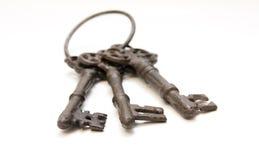 Tre vecchie chiavi nel fuoco Fotografia Stock Libera da Diritti