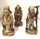 Tre vecchie figure asiatiche del guru immagine stock