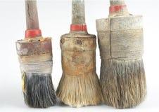 Tre vecchie spazzole Fotografia Stock