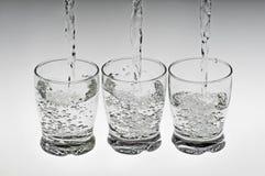 Tre vetri con acqua Immagine Stock