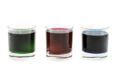 Tre vetri con i cocktail multi-coloured Fotografie Stock