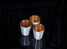 Tre vetri del metallo dell'oro Fotografie Stock