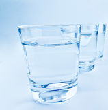 Tre vetri della bevanda con il concetto dell'acqua, di nutrizione e di sanità Fotografia Stock