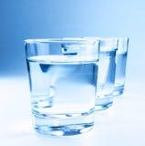 Tre vetri della bevanda con il concetto dell'acqua, di nutrizione e di sanità Fotografia Stock Libera da Diritti