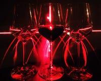 Tre vetri di vino davanti al laser Immagini Stock Libere da Diritti