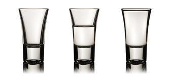 Tre vodkaexponeringsglas Arkivbilder