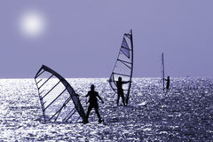Tre windsurfers Fotografia Stock