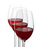 Tre wineglases con vino rosso fotografia stock