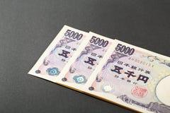 Tre yen för japansedel 5000 Arkivfoton