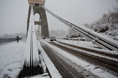 Treacherous conditions crossing Clifton Suspension bridge in the. Clifton, Bristol, UK - January 18, 2013: People struggle to get to work given heavy amounts of Stock Photography