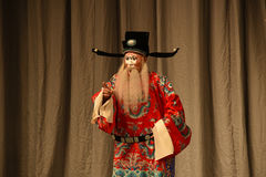"""Treacherous court official- Beijing Opera"""" Women Generals of Yang Family"""". This opera tells a patriotic story how does an old woman of a hundred Stock Photos"""