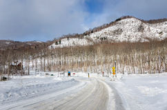 Treacherous Curving Road Covered in Snow. In Quebec, Canada. Concept of Danger Royalty Free Stock Image