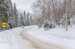 Treacherous Driving Conditions. Dangerous Curve Covered in Snow during a heavy snowfall Royalty Free Stock Image