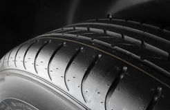 Tread block pattern of symmetrical tire macro shot. Dimples and sipes on the sidewall of summer tire detailed Royalty Free Stock Images