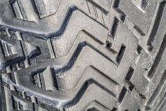The tread of a car tire closeup Royalty Free Stock Images