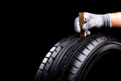 Tread depth. Car tires during service in the workshop royalty free stock photography