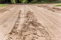 Tread marks on dry rural sandy road Royalty Free Stock Photo