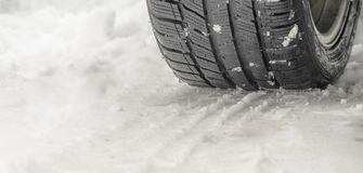 Tread of a winter tire on the snow close up royalty free stock image