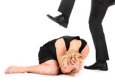 Treading on employee. A picture of a male leg treading on a female employee over white background Royalty Free Stock Images
