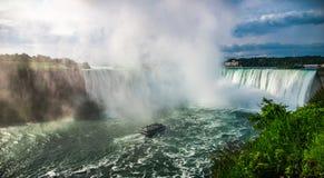 Treading into the mist of Niagara Falls. Royalty Free Stock Photos