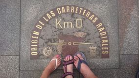 Km 0, Madrid, Spain. Treading the square 0 km of sun, Madrid, Spain stock photos
