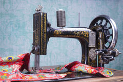 Treadle sewing machine. Antique treadle black sewing machine Royalty Free Stock Image