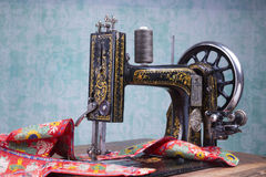 Treadle sewing machine. Antique treadle black sewing machine Stock Photo