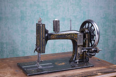 Treadle sewing machine. Black antique treadle sewing machine Stock Image