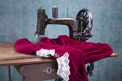Treadle sewing machine. Black antique treadle sewing machine Royalty Free Stock Photo