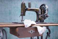 Treadle sewing machine. Black antique treadle sewing machine Stock Photo