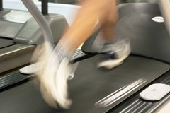 Treadmill. Running on a treadmill (motion blur) at a gym royalty free stock images