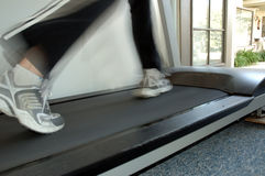 Treadmill 3. Running on home treadmill stock photo