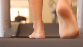 Treadmill cardio workout. Man walk on treadmill cardio workout stock footage