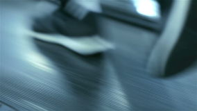 Treadmill closeup. Feet running on stock footage