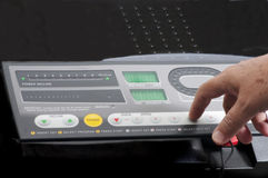 Treadmill Controls. Male hand using the controls of a modern treadmill Stock Photography