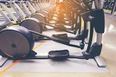 Treadmill and diverse equipment for exercise strong muscle in fitness gym royalty free stock images