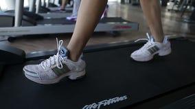 Treadmill exercise machine, exercise on cardio fitness equipment. Running on the treademill, exercise on cardio fitness equipment, gym stock video footage
