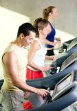 On the treadmill in gym Royalty Free Stock Photography