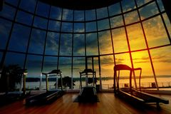 Treadmill interior with forest river sky cloud view in sunrise h stock image