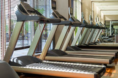 Treadmill machines in gym Stock Images