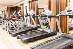 Treadmill in Modern gym interior with equipment Royalty Free Stock Photos