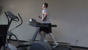 Treadmill run. Young man running on a treadmill stock video footage