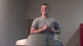 Treadmill running. Young man running on a treadmill. medium shot stock footage