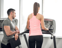 Treadmill walk with personal trainer. Royalty Free Stock Photos