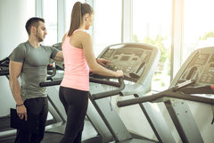 Treadmill walk with personal trainer. Royalty Free Stock Photography
