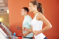 On a treadmill Stock Photos