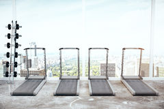 Treadmills and dumbbells Royalty Free Stock Images